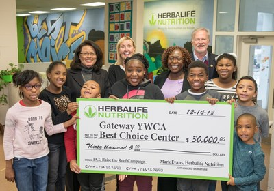 Children from the Gateway YWCA Best Choice Center Program celebrate a $30,000 grant from Herbalife Nutrition to help replace an aging and damaged roof.  Mark Evans, general manager of the Herbalife Nutrition Innovation and Manufacturing Facility in Winston-Salem and Annie Tyson Jett, Senior Manager of Human Resources presented the check today to Christy Respess, President & CEO, Gateway YWCA and Marilyn Odom, VP for Youth Services, Director of the Best Choice Center.