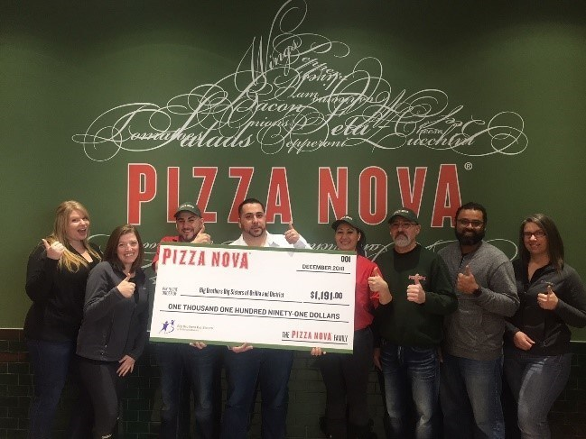 From left to right: Jill Brazda, BBBS Orillia Board Member, Miranda Chaffey, BBBS Orillia Mentoring Coordinator, Pizza Nova Franchisee Esmeralda Proko,  Pizza Nova Franchisee, Dave Strugga, Pizza Nova District Manager, Carlos Duarte, Pizza Nova Franchisee, Plarent Strugga, Atma Maharaj, BBBS Orillia Board Chair, Amanda Tevelde, BBBS Orillia Community Relations Coordinator. (CNW Group/Pizza Nova)