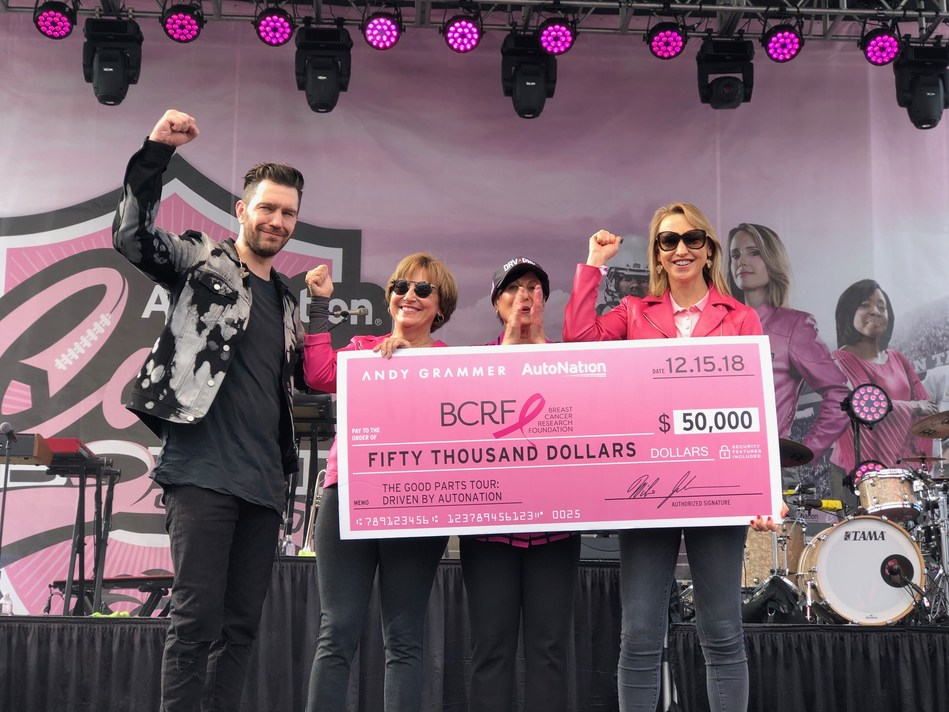 After giving an energizing and inspiring concert performance, Andy Grammer, Multi-Platinum Recording Artist, together with Marc Cannon, EVP & CMO of AutoNation, and Alice Jackson, Wife of AutoNation's Chairman, CEO & President, present a check for $50,000 to Myra Biblowit, President & CEO of the Breast Cancer Research Foundation, and Kinga Lampert, Co-Chair of the Board of Directors of the Breast Cancer Research Foundation. This money was raised through AutoNation and Andy Grammer's partnership.
