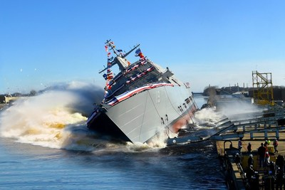 The 19th Littoral Combat Ship, the future USS St. Louis, launches sideways into the Menominee River in Marinette, Wisconsin, on Dec. 15.