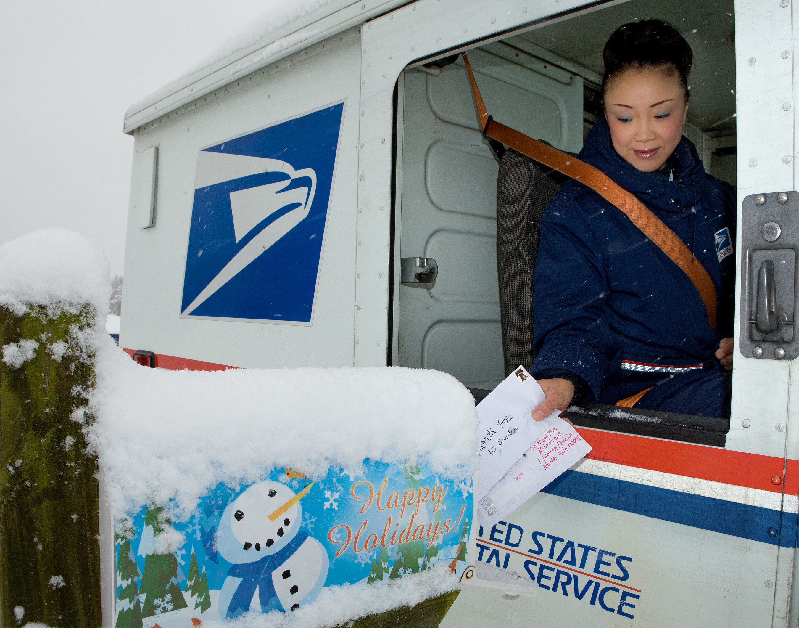 USPS carrier delivers mail, Photo courtesy: USPS