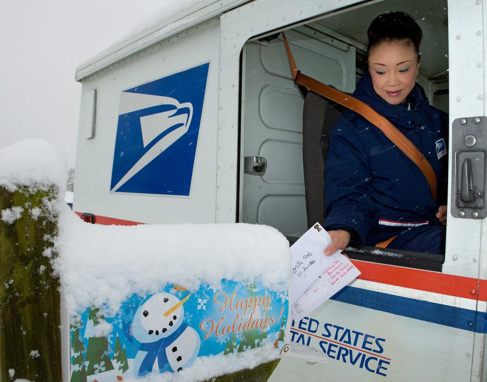 USPS carrier delivers mail, Photo courtesy: USPS
