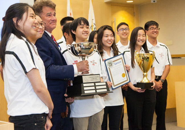 Winning team from Troy High School pictured left to right: Kanin Liang, Jennifer Ho, Mayor Doug Chaffee, Jino Si rivatanarat, Charissa Kim, Brandon Shin, Ha Young Kong, Silas Shen. Not visible are Jared Flores, David Lee, Minh Khoa Nguyen and Nicole Wong presenting the 2018 Orange County California Mayors Cyber Cup to Mayor of Fullerton Doug Chaffee