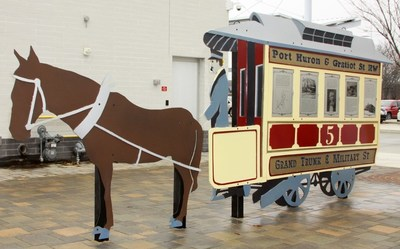SCULPTURE CAPTURES TRANSIT HISTORY: Blue Water Area Transit's unveiled sculpture tells the story of transit innovation in Port Huron, Michigan, starting some 150 years ago with William Pitt Edison's horse-pulled trolley service. (photo by Rose Norton).