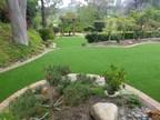Artificial Grass Installation Enhances a Backyard Oasis