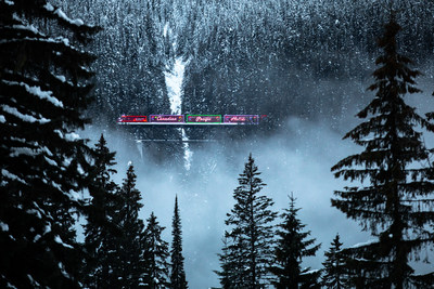 The CP Holiday Train passes over Surprise Creek as it travels through Rogers Pass, BC. Photo credit Neil Zeller. (CNW Group/Canadian Pacific)