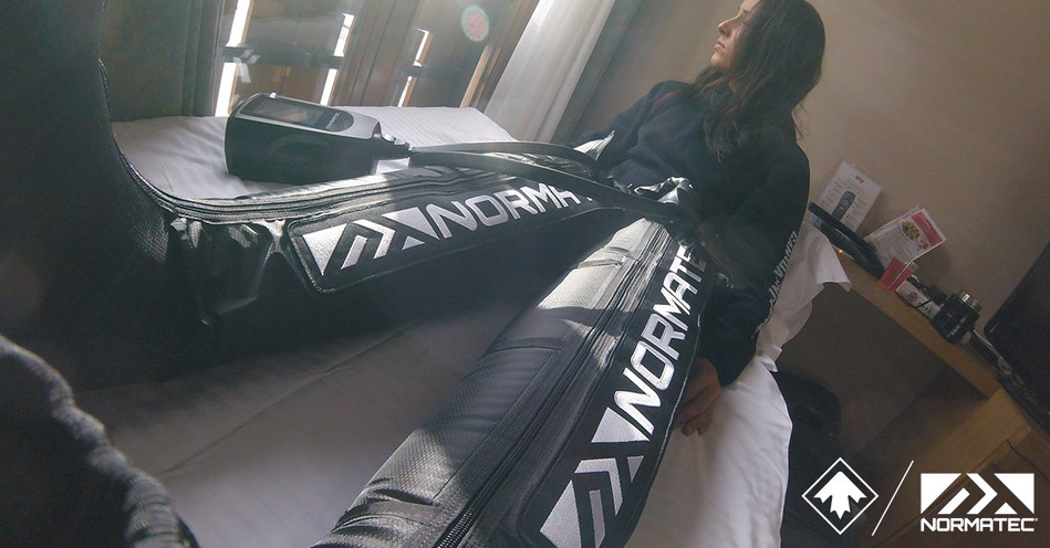 Carle Brenneman of Canada Snowboard's Snowboardcross National Team recovering with NormaTec.