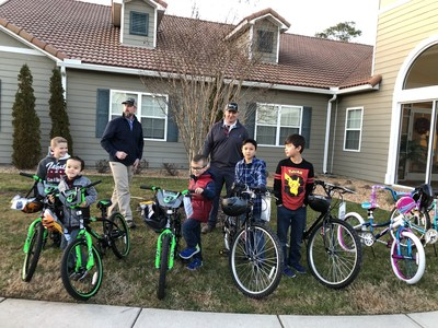 Essay winners from Langley Family Housing receive their new bicycles.