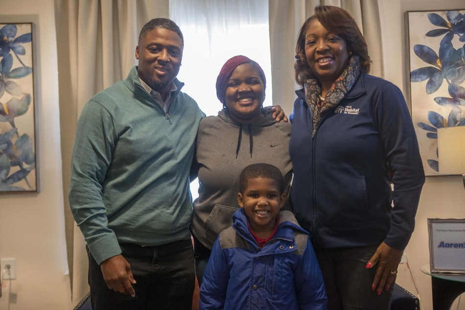 In Atlanta, new homeowner Ronyelle and her 5-year-old son were surprised by former NFL star Warrick Dunn and Aaron's representatives with a home filled with furniture and electronics just in time to celebrate Christmas, thanks to the combined efforts of Aaron's, Progressive Leasing, Warrick Dunn Charities (WDC) Homes for the Holidays program and Atlanta Habitat for Humanity. In partnership with Aaron's and Habitat for Humanity affiliates, WDC assists single parents in becoming first-time homeowners.