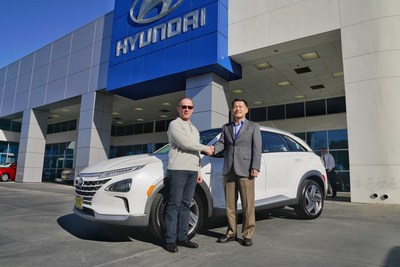 Yong-woo (William) Lee, president and CEO of Hyundai Motor North America, congratulates Tom Hochrad of Ventura, Calif., the first customer to receive the all-new Hyundai Nexo. Nexo is the only mass-produced fuel cell SUV for the U.S. market, boasting a range up to 380 miles.