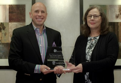 Michael S. Young (left) accepts the Top Global Asset Manager Award for measured net returns in a five-year period from Autumn Gold Founder Kim Avery (right).