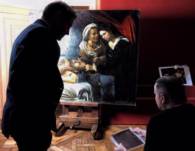Eric Turquin and thierry Ehrmann beside the Caravage (PRNewsfoto/Artprice.com)