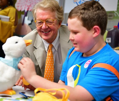 "Aflac Chairman and CEO Dan Amos with a 13 year old patient at the Aflac Cancer and Blood Disorders Center in Atlanta, GA admiring the My Special Aflac Duck at a ""duck delivery"" event in September."