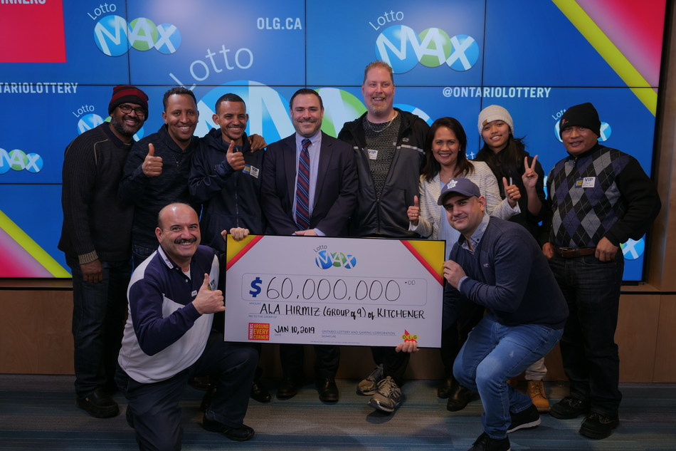 OLG's Senior Vice President of Enterprise Strategy and Analytics, Dave Pridmore (centre), celebrates a $60 million win with a group of nine from southern Ontario. The group won the December 21, 2018 LOTTO MAX jackpot. (CNW Group/OLG Winners)
