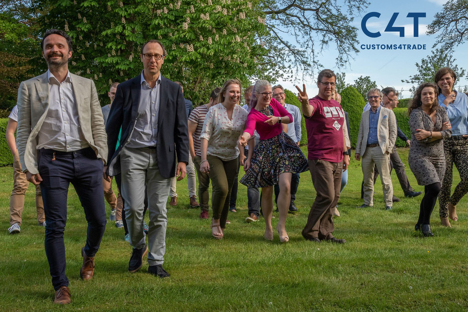 Team picture after a formal photoshoot in the garden of Customs4trade's new office in Zemst, featuring their CEO and COO. Picture shows the dynamic of the team very well.