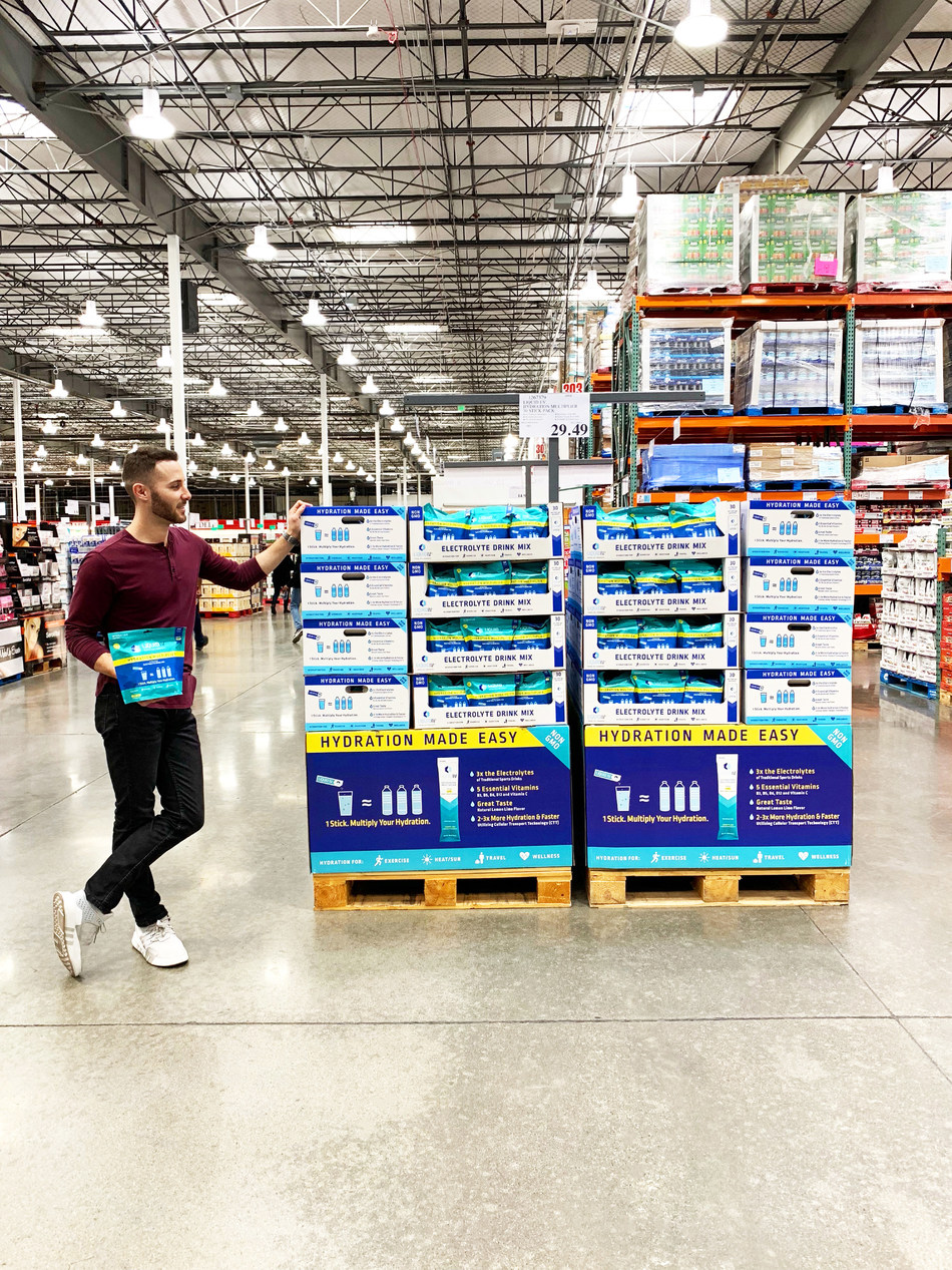 Brandin Cohen, founder and CEO of Liquid I.V., stands with palettes of Hydration Multiplier at Costco.