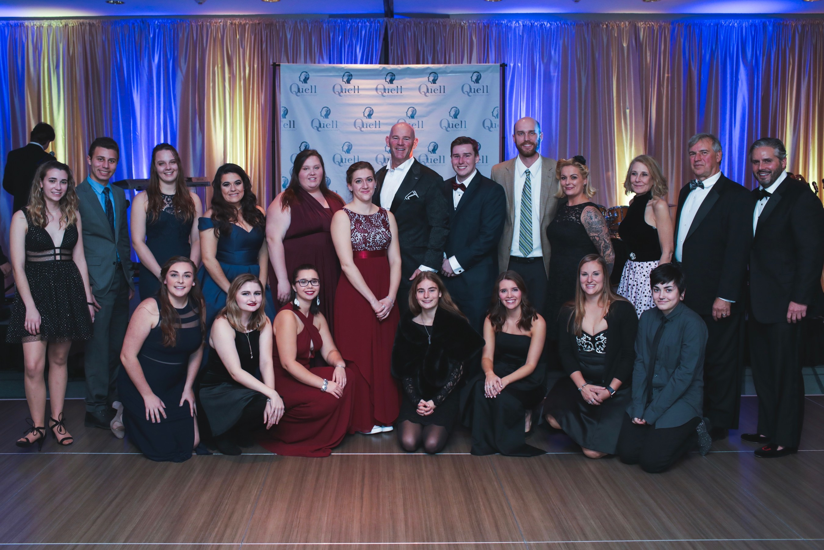 CEO Kevin Lynch and a group of Quell Scholars at the 2018 Quell Foundation Masquerade Ball.