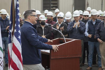 Kevin Graney, President of General Dynamics NASSCO, addresses a crowd of shipbuilders as the company commissioned a new panel line in the San Diego shipyard January 11, 2019.