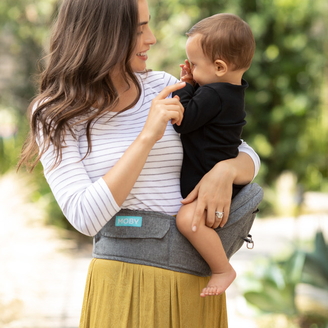 MOBY 2-in-1 Baby Carrier + Hip Seat combines the support of a standard ergonomic baby carrier with the simple carrying assistance of a hip seat in one versatile, convenient baby wearing product covering infants to toddlers.