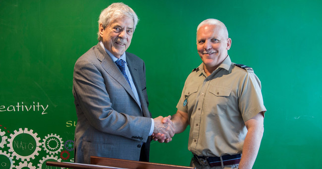 AECT Executive Director Dr. Philip Harris and NATO ACT's Air Marshal Sir Graham Stacey, Chief of Staff, after signing agreement.