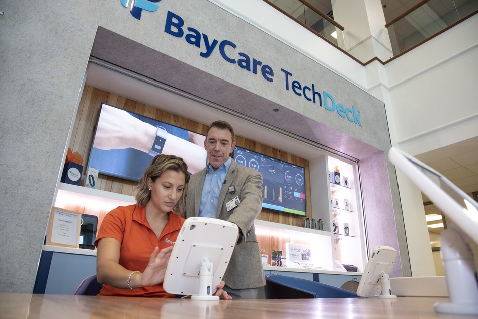 BayCare's director of Innovation, Craig Anderson, and health tech coach, Beth Weiner, test one of the iPads at BayCare TechDeck.