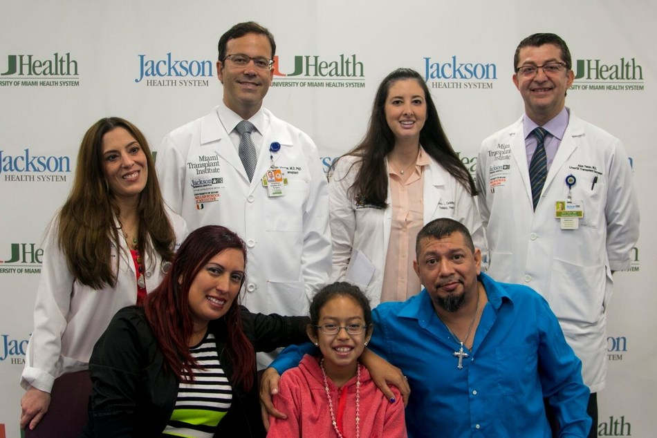 Transplant recipient, Victoria Rojas, pictured front row center with her parents Mary Ann Rojas and Jenaro Rojas. Second row: Experts at the Miami Transplant Institute at the University of Miami/Jackson Memorial Hospital. From left, Jennifer Garcia, M.D.; Rodrigo Vianna, M.D. director, Miami Transplant Institute, Dana Goldner, M.D. and Akin Tekin, M.D.