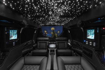 "Lexani Motorcars Cadillac Escalade 30"" Extended Viceroy Captain's Quarters featuring magnetic docked I-Pads, control 4 touchscreen management console, and 48"" curved Smart TV"