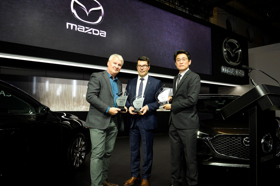 Massey Kondo, President, Mazda Canada, and Jacques Parent, Quebec Regional Manager, Mazda Canada, accept three AJAC awards from Mark Richardson, President, AJAC (CNW Group/Mazda Canada Inc.)