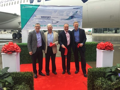 (From Left to Right) Brad McMullen, Boeing Vice-President of Sales for the Americas, Clive Beddoe, WestJet Founder and Chairman, Ed Sims, WestJet President and CEO and Robert Manelski, Boeing Director of 787 Manufacturing, cut the ribbon at WestJet's delivery ceremony today at Boeing. (CNW Group/WESTJET, an Alberta Partnership)