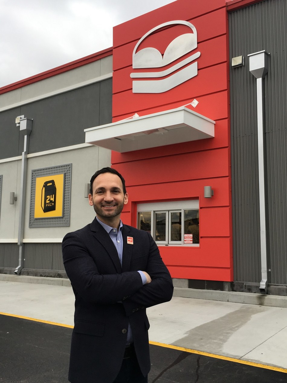 Krystal President and CEO Paul Macaluso stands under the abstract burger emblem at the newly redesigned and reopened Krystal at 7300 Shallowford Road in Chattanooga, Tennessee.