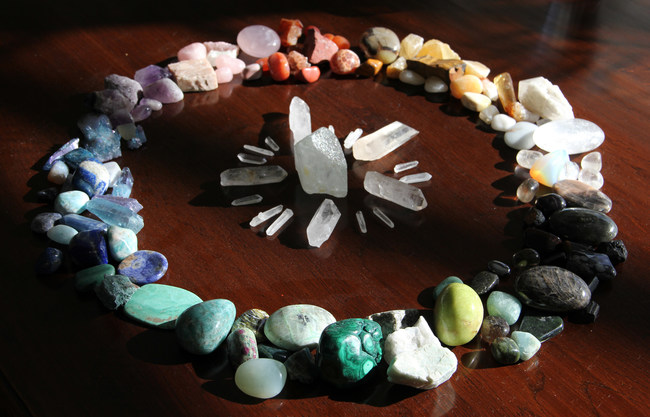 Lisa's favorite crystals displayed in a healing circle on her desk.