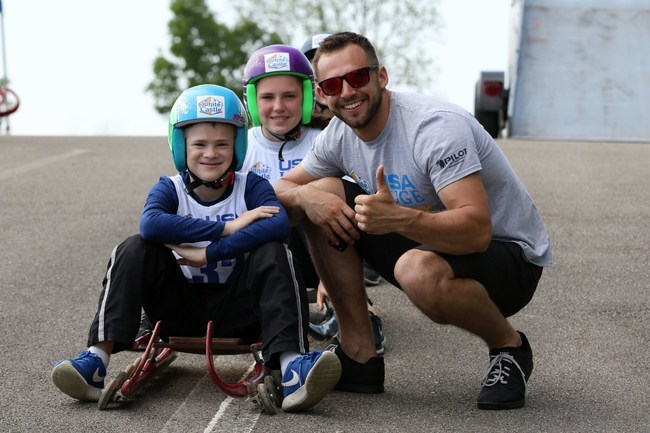 USA Luge athlete and Winter Olympic sliver medalist, Chris Mazdzer, teaches children how to luge during the White Castle USA Luge Slider Search.