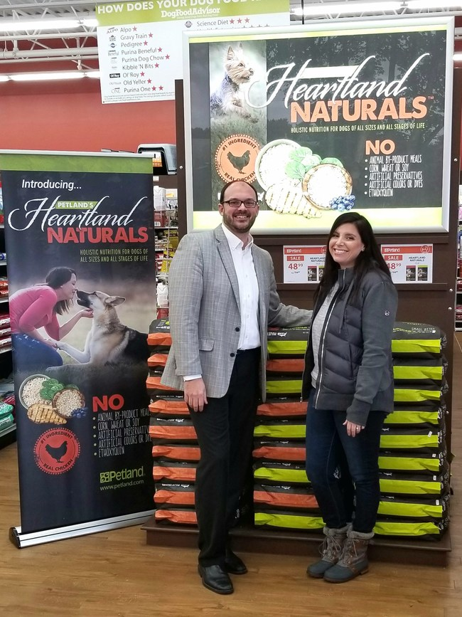 Petland Charities Executive Director Steve Huggins and Ross County Humane Society Executive Director Jenn Thomas celebrate new partnership to feed shelter pets.