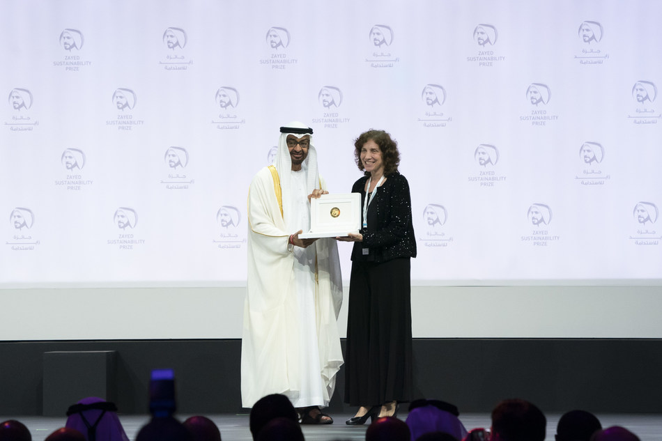 ABU DHABI, UNITED ARAB EMIRATES - January 14, 2019: HH Sheikh Mohamed bin Zayed Al Nahyan, Crown Prince of Abu Dhabi and Deputy Supreme Commander of the UAE Armed Forces (L), presents an award to Dr. Laura Stachel, Executive Director and Co-founder of 'We Care Solar,' winner of the Zayed Sustainability Prize
