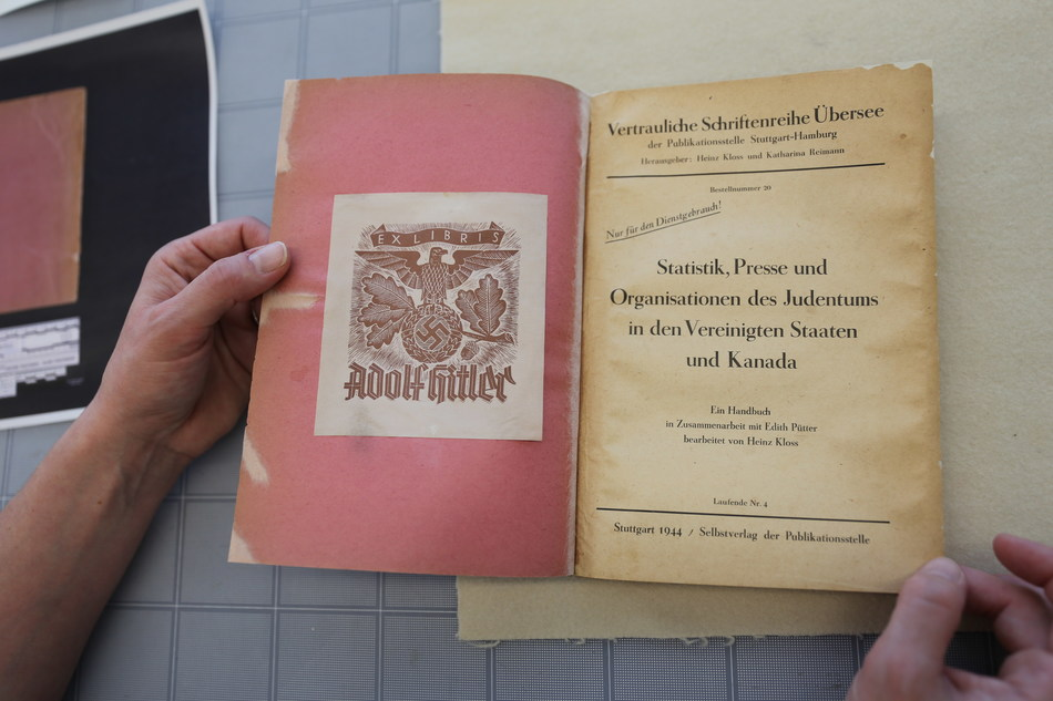 """The bookplate bears a stylized eagle, swastika, and the words """"EX LIBRIS ADOLF HITLER"""" indicating it came from Hitler's personal library. (CNW Group/Library and Archives Canada)"""