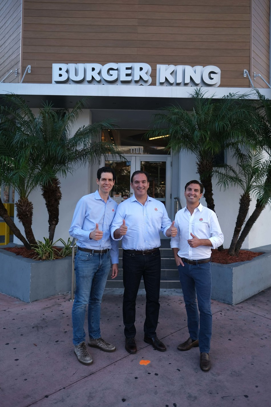 (L to R): Daniel Schwartz (Executive Chairman of RBI and co-Chairman of RBI's Board of Directors), Jose Cil (CEO of RBI) and Josh Kobza (COO of RBI) visit a Burger King restaurant in South Beach, Miami. (CNW Group/Restaurant Brands International Inc.)
