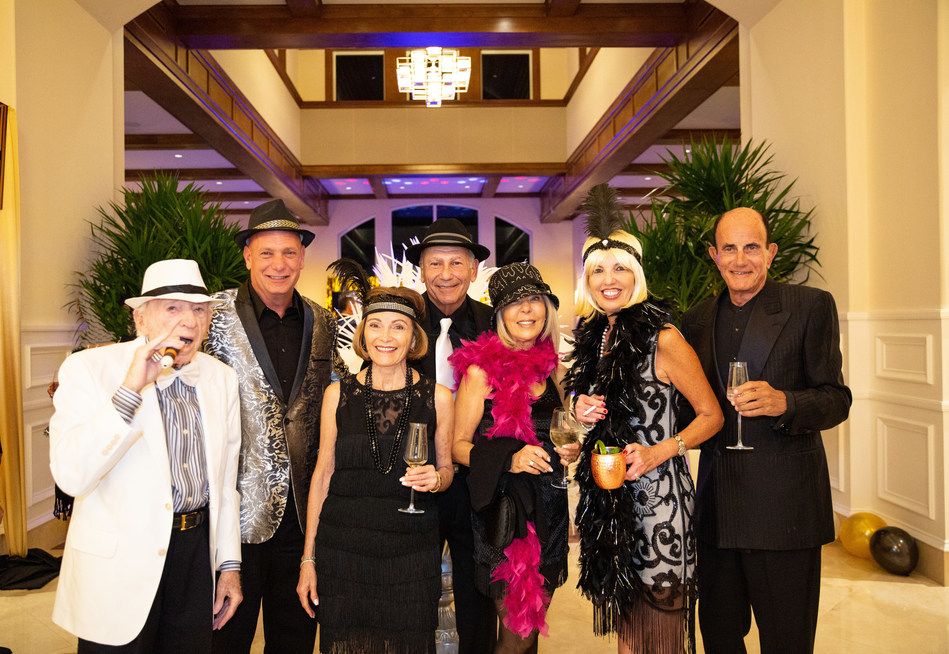 BallenIsles Members share a toast in the BallenIsles Grand Lobby before joining the Roaring 20's Great Gatsby-style Speakeasy Soiree celebrating the $35 million Clubhouse Grand Opening.