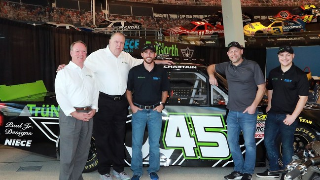 The TruNorth Paul Jr. Designs NASCAR truck was unveiled at the NASCAR Hall of Fame. Pictured L-to-R: Barry Wilson and Lance Eskridge of TruNorth; NASCAR driver Ross Chastian; Paul Teutul Jr. of Paul Jr. Designs; NASCAR driver Reid Wilson