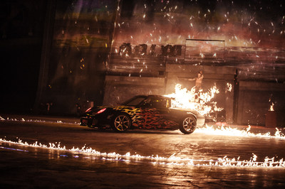 One eye-catching highlight includes setting a Porsche on fire and driving it around the arena while motorcycle riders and buggy drivers chaotically drop in from the top of a huge projection screen at a height of 12 meters, at an incredibly steep 65 degree angle and come screeching to a halt just a couple meters from the audience.
