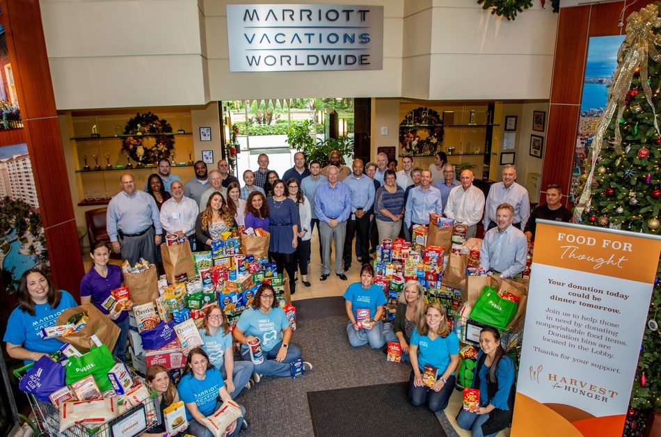 Associates at Marriott Vacations Worldwide's Corporate Headquarters in Orlando, Fla. with a portion of their local food donation for the annual Harvest for Hunger food drive.