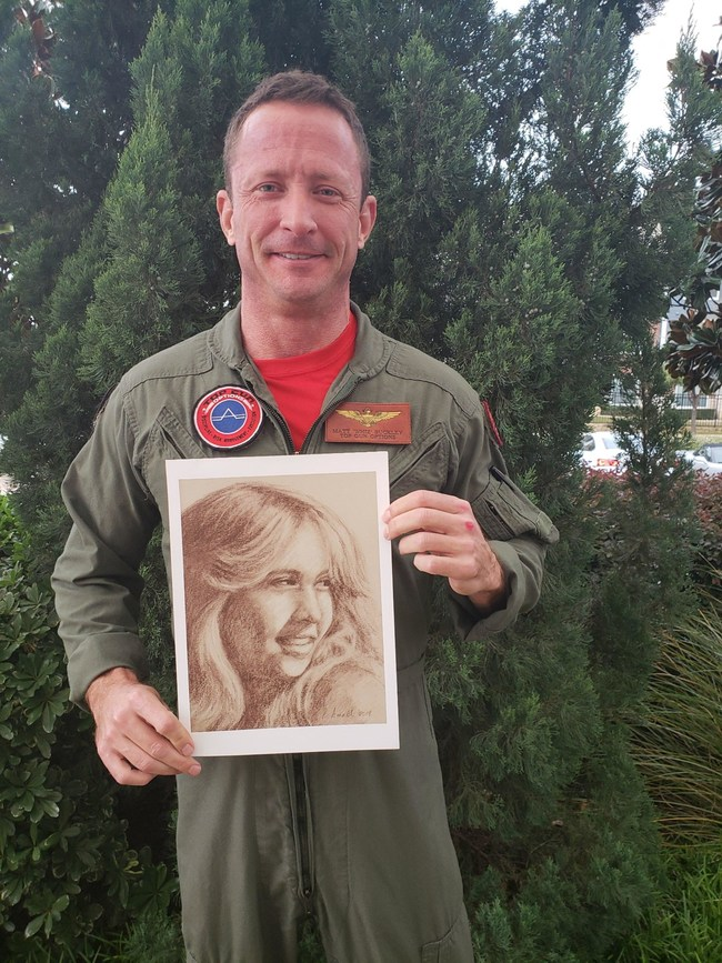 E. Matthew 'Whiz' Buckley holding a picture of his sister Monica, who was killed by a drunk driver in 1982
