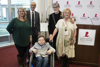 Musician Randy Owen, his wife, ALSAC CEO Richard Shadyac, Jr., St. Jude patient Caleb and his mom Kelly stand by a plaque honoring Owen for his dedication to the life-saving mission of St. Jude Children's Research Hospital during a press conference at the Country Cares seminar at St. Jude Children's Research Hospital on Friday, January 25, 2019.