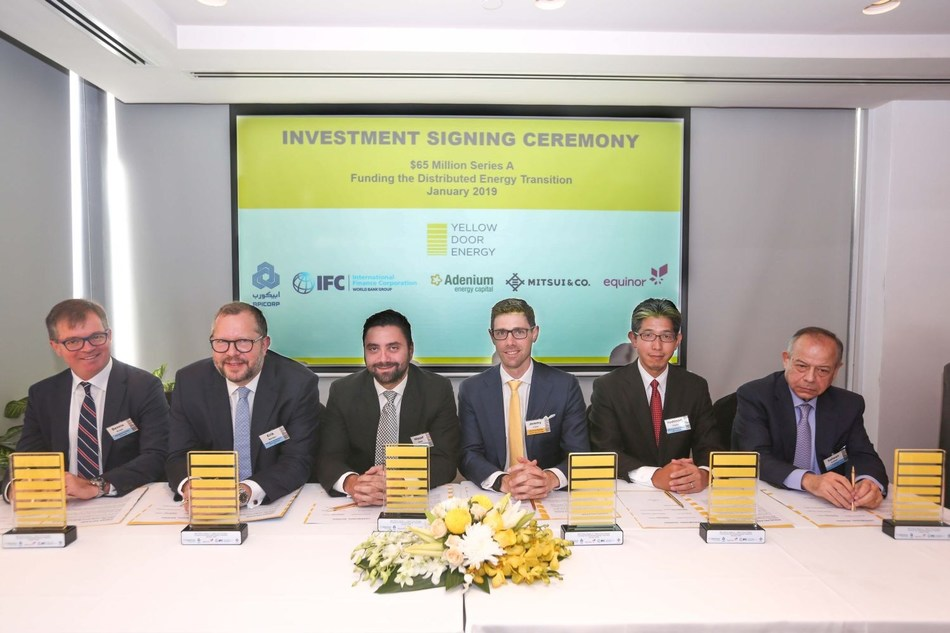 The signing ceremony took place in Dubai, celebrating Yellow Door Energy raising $65 million from leading global investors. (PRNewsfoto/Yellow Door Energy)
