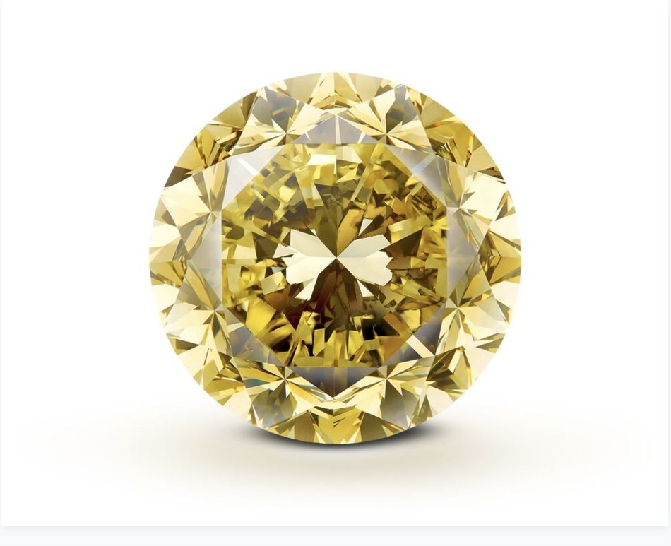 Mouawad Crafted From the Rough 54.21 Carat 'Mouawad Dragon' Diamond - the Largest Round Brilliant Vivid Yellow Diamond in the World (PRNewsfoto/Mouawad)