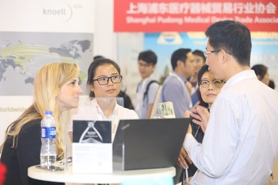 Exhibitors are engrossed in communicating with visitors