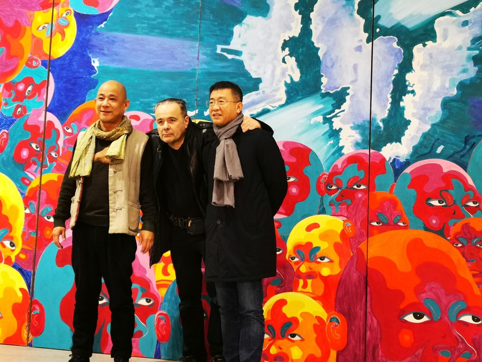 The artist Fang Lijun in his studio, welcoming Wan Jie (Chairman of the Artron Group), on the right, and thierry Ehrmann (Artprice Chairman), in the center. (PRNewsfoto/Artprice.com)