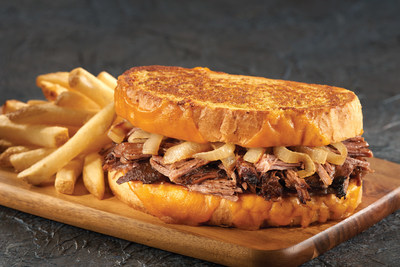 Kings Pot Roast Grilled Cheese made with slow cooked pot roast, cheddar cheese, sauteed onions and Dijon-mayo spread, served on grilled sourdough.