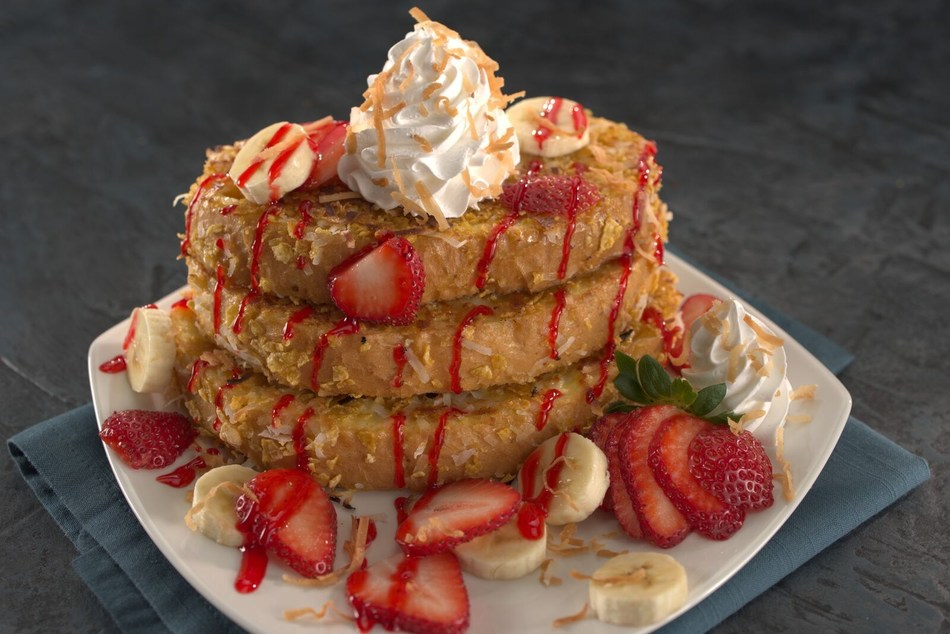 Kings Maui Stack French Toast. Three slices of sourdough bread, battered and grilled with Frosted Flakes and toasted coconut, topped with sliced bananas, strawberries, strawberry sauce and whipped cream.