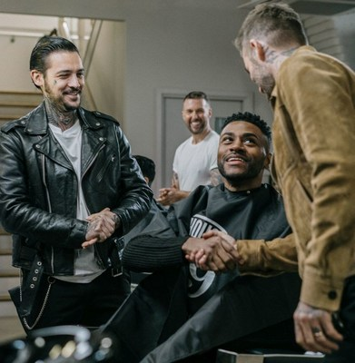 David Beckham surprises HOUSE 99 fans, As part of House 99 first anniversary celebrations a grooming experience was gifted to 10 customers in London. The lucky 10 chosen were surprised by brand founder, David Beckham dropping by the barbershop (PRNewsfoto/HOUSE 99 by David Beckham)