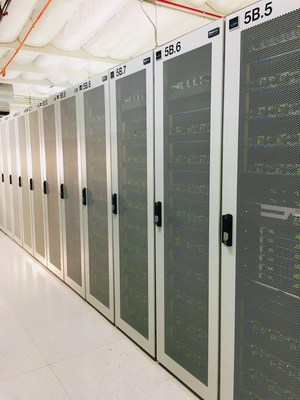 A row of fully-packed DGX cabinets inside Colovore's Santa Clara data center; there are close to 1,000 DGX-1s and DGX-2s already running at Colovore